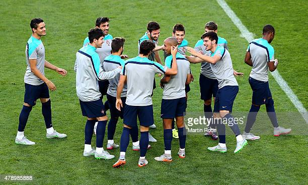Team members of Portugal joke with Joao Mario during a training session ahead of the UEFA European Under21 final match against Sweden at Eden Stadium...