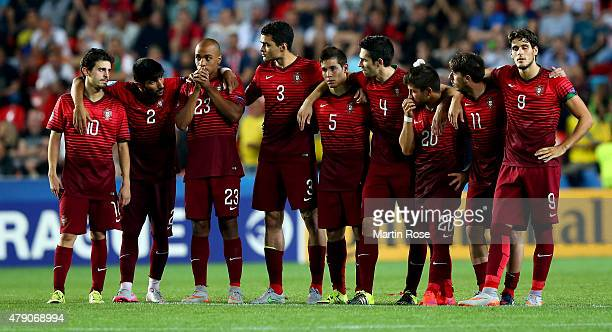 Team members of Portugal reacts during penalty shoot out during the UEFA European Under21 final match between Sweden and Portugal at Eden Stadium on...