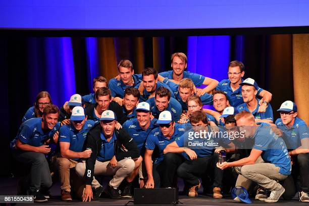 Team members of Punch Powertrain Solar Team vehicle 'Punch Two' from Belgium celebrate after receiving their trophy at the 2017 Bridgestone World...