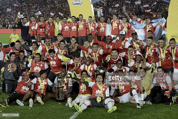 Team members of Santa Fe pose for a photo to celebrate with the trophy after winning the Liga Aguila II 2016 tournament after a second leg final...