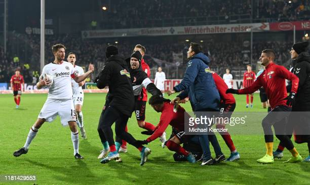 Team members of SC Freiburg trying to confront David Angel Abraham of Eintracht Frankfurt during the Bundesliga match between Sport-Club Freiburg and...