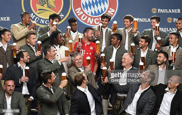 Team members of the German first division Bundesliga football club FC Bayern Munich pose with a supporter during a promotional photocall of the...