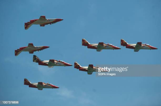 Team members of the Spanish Air Force 'Patrulla Aguila' perform on the air during the 2018 Torre del Mar International Air Festival in Torre del Mar...