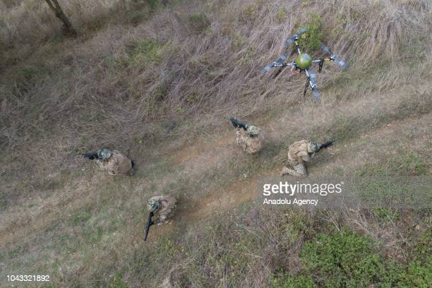Team members of the 'Underwater Defence' the special operation unit of the Turkish Navy take part in a military training using drone unmanned aerial...