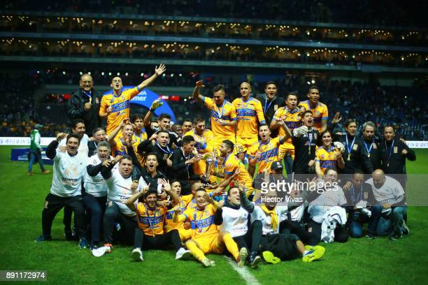 Team members of Tigres pose for a group photo after winning the second leg of the Torneo Apertura 2017 Liga MX final between Monterrey and Tigres...