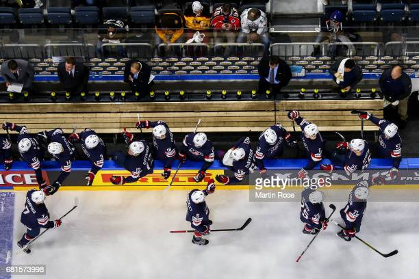 Team members of USA celebrate after scoring a goal during the 2017 IIHF Ice Hockey World Championship game between USA and Italy at Lanxess Arena on...