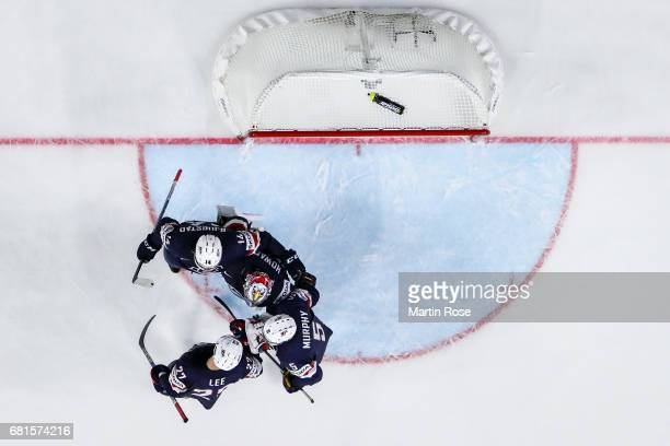 Team members of USA celebrate after winning the 2017 IIHF Ice Hockey World Championship game between USA and Italy at Lanxess Arena on May 10, 2017...
