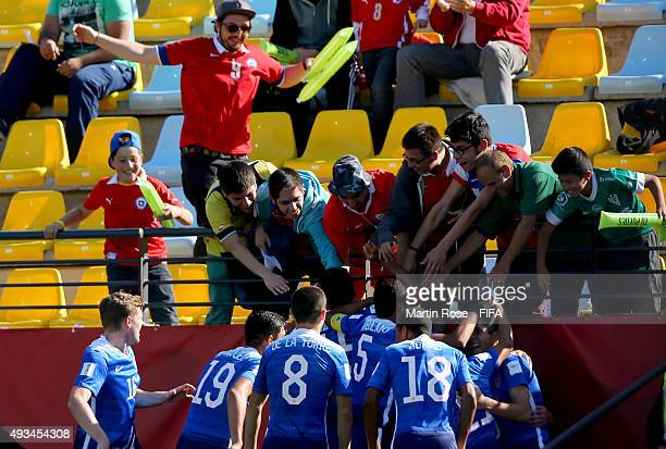 Team members of USA celebrate their opening goal during the FIFA U17 Men's World Cup 2015 group A match between USA and Croatia at Estadio Sausalito...