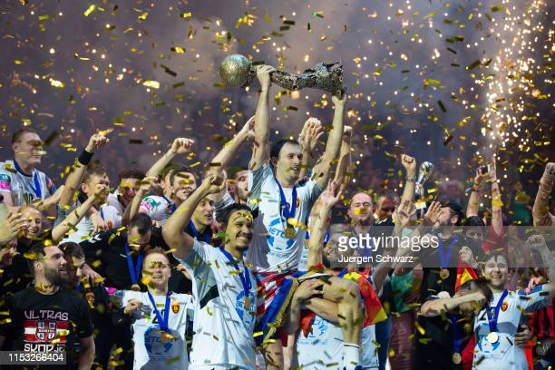 Team members of Vardar celebrate with the trophy after winning the VELUX EHF Champions League final match between HC Vardar and Telekom Veszprem HC...