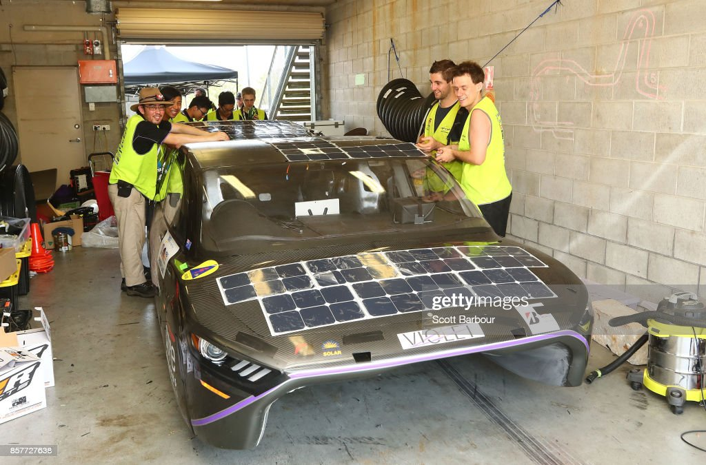 Team members prepare in their pit garage before Violet, the car from Australia's UNSW Solar Racing Team Sunswift is tested on track at the Hidden Valley Motor Sport Complex before competing in the Cruiser class ahead of the 2017 Bridgestone World Solar Challenge on October 5, 2017 in Darwin, Australia. Teams from across the globe are competing in the 2017 World Solar Challenge - a 3000 km solar-powered vehicle race through the Australian Outback between Darwin and Adelaide. The race attracts teams from around the world, most of which are fielded by universities or corporations although some are fielded by high schools. The race has a 30-year history spanning thirteen races, with the inaugural event taking place in 1987. The race begins on October 8th with the first car expected to cross the finish line on October 11th.