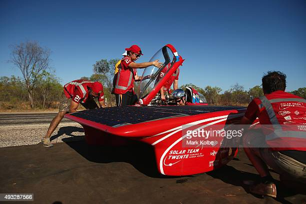 Team members prepare their car Red One of Solar Team Twente Netherlands before racing in the Challenger Class between Dunmarra and Elliott during day...
