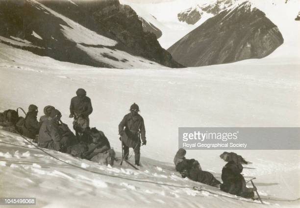 [Team members resting in the snow] Tibet China Mount Everest Expedition 1921