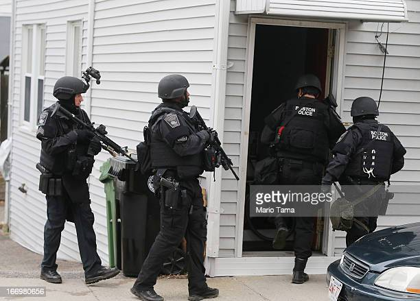 Team members search for one remaining suspect at a residential building on April 19, 2013 in Watertown, Massachusetts. Earlier, a Massachusetts...