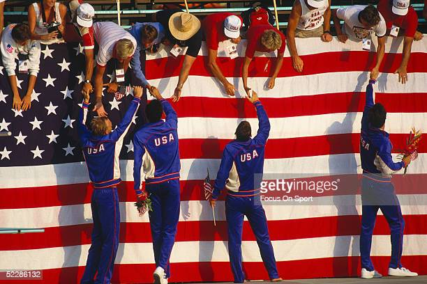 USA team members shake hands with people in the crowd during the 1984 Summer Olympics games in Los Angeles California