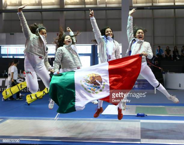 Team Mexico celebrates their bronze medal win during the Junior Team Women's Sabre Event at the Junior and Cadet World Fencing Championships on April...