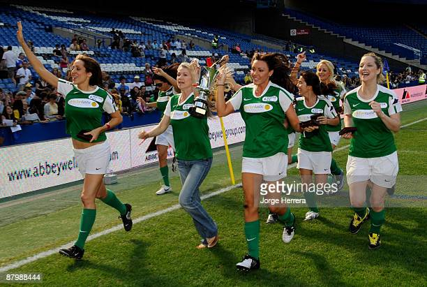 Team Michele and Caprice celebrate winning the Girls tournament of Celebrity Soccer Six charity football tournament at Chelsea Football Club Stamford...