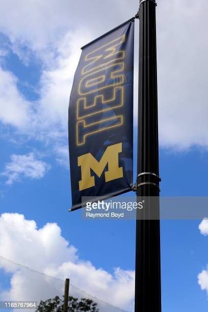 Team Michigan' banner flies outside Michigan Stadium, home of the Michigan Wolverines football team and women's lacrosse team in Ann Arbor, Michigan...