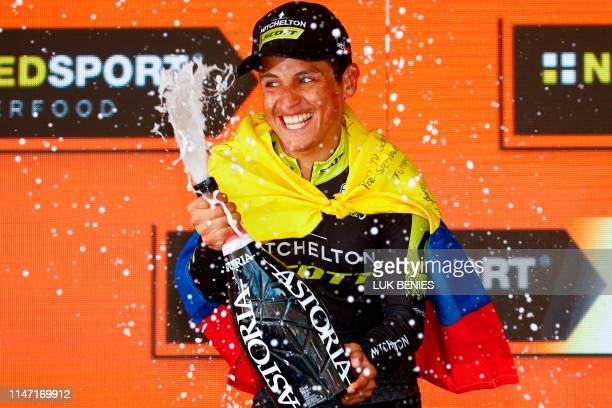 Team Mitchelton rider Colombia's Esteban Chaves sprays champagne as he celebrates on the podium after winning stage nineteen of the 102nd Giro...