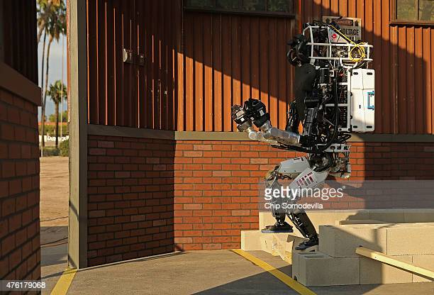 Team MIT's Helios Atlas robot steps down from the rubble task during the Defense Advanced Research Projects Agency Robotics Challenge at the Fairplex...