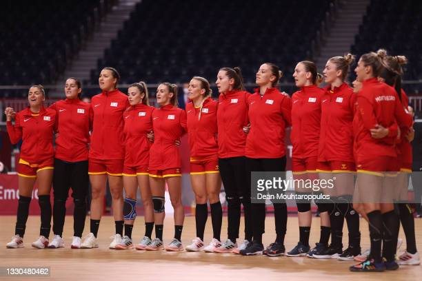 Team Montenegro are seen standing for their national anthem ahead of the Women's Preliminary Round Group A match between Montenegro and Angola on day...