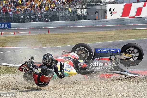 Team Moto2 Spanish rider Alex Pons falls with QMMF Racing team Belgiqn rider Xavier Simeon during the Moto2 race of the San Marino Moto GP Grand Prix...