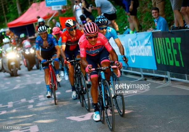 Team Movistar rider Ecuador's Richard Carapaz wearing the overall leader's pink jersey followed by Team Movistar rider Spain's Mikel Landa and Team...
