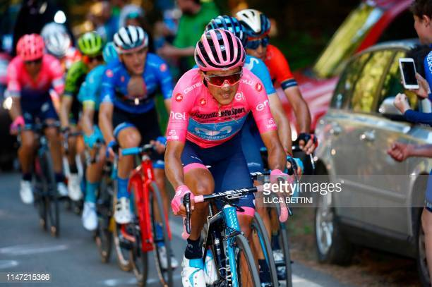 Team Movistar rider Ecuador's Richard Carapaz wearing the overall leader's pink jersey rides in the last kilometer of the Monte Avena ascent during...