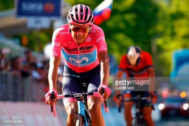 Team Movistar rider Ecuador's Richard Carapaz wearing the overall leader's pink jersey crosses the finish line of stage twenty of the 102nd Giro...