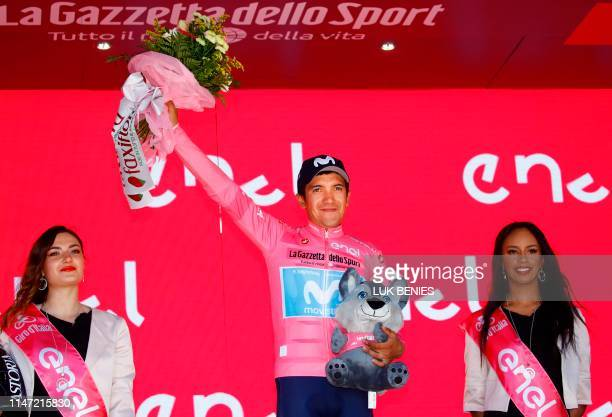 Team Movistar rider Ecuador's Richard Carapaz wearing the overall leader's pink jersey celebrates on the podium after stage twenty of the 102nd Giro...