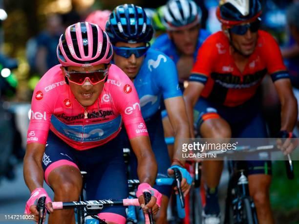 Team Movistar rider Ecuador's Richard Carapaz wearing the overall leader's pink jersey Team Movistar rider Spain's Mikel Landa and Team Bahrain rider...