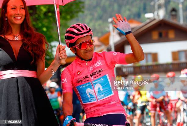 Team Movistar rider Ecuador's Richard Carapaz with the pink jersey of overall leader prepares to take part in stage eighteen of the 102nd Giro...