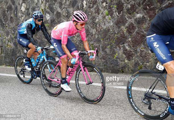 Team Movistar rider Ecuador's Richard Carapaz with the pink jersey of overall leader takes part in stage eighteen of the 102nd Giro d'Italia Tour of...