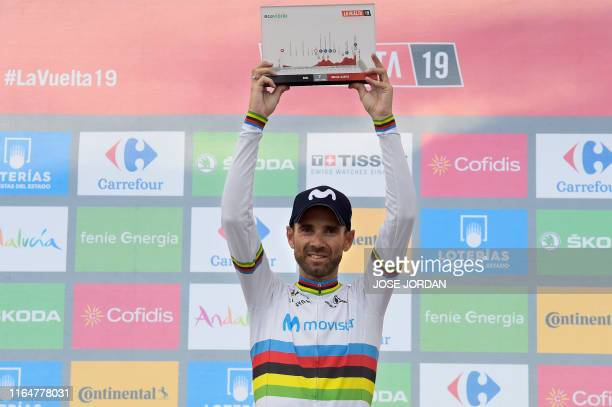 Team Movistar rider Spain's Alejandro Valverde celebrates on the podium after winning the seventh stage of the 2019 La Vuelta cycling tour of Spain a...