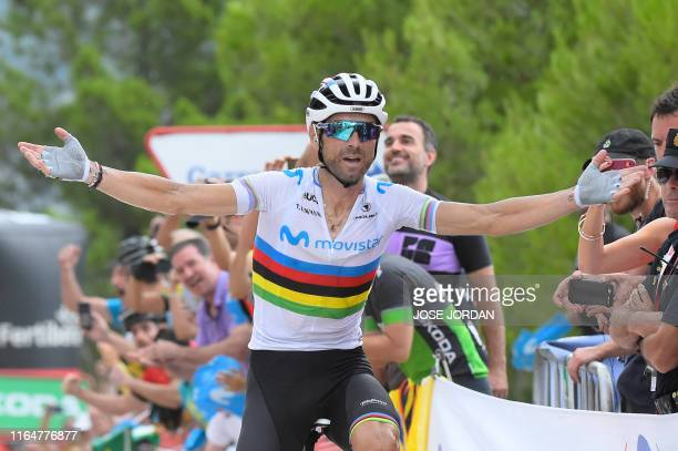 Team Movistar rider Spain's Alejandro Valverde crosses the finish line and wins the seventh stage of the 2019 La Vuelta cycling tour of Spain, a 183,...