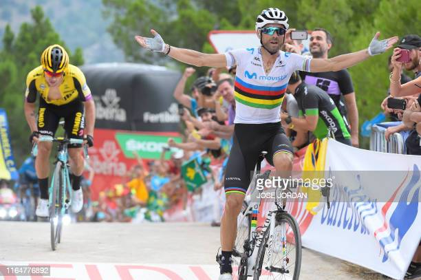 Team Movistar rider Spain's Alejandro Valverde crosses the finish line in front of Team Jumbo rider Slovenia's Primoz Roglic and wins the seventh...