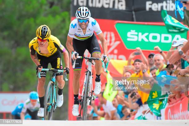 Team Movistar rider Spain's Alejandro Valverde rides to cross the finish line in front of Team Jumbo rider Slovenia's Primoz Roglic and wins the...