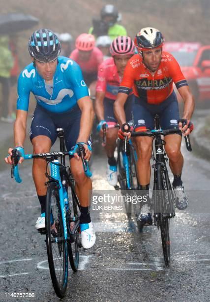 Team Movistar rider Spain's Mikel Landa climbs followed by Team Bahrain rider Italy's Vincenzo Nibali and Team Movistar Ecuadorian Richard Carapaz...