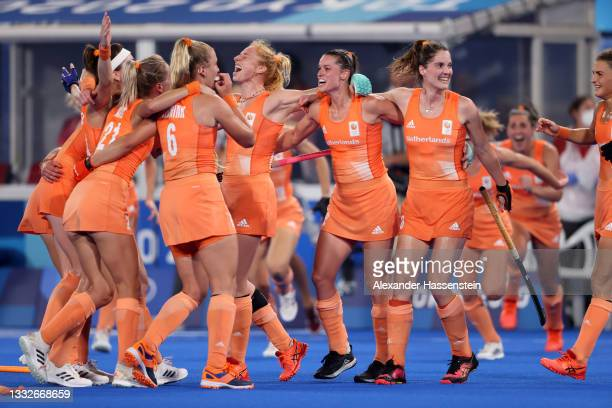 Team Netherlands celebrate victory in the Women's Gold Medal match between Netherlands and Argentina on day fourteen of the Tokyo 2020 Olympic Games...