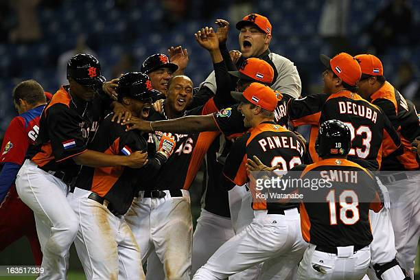 Team Netherlands celebrates after winning the World Baseball Classic Second Round Pool 1 game between against the Cuba at Tokyo Dome on March 11 2013...