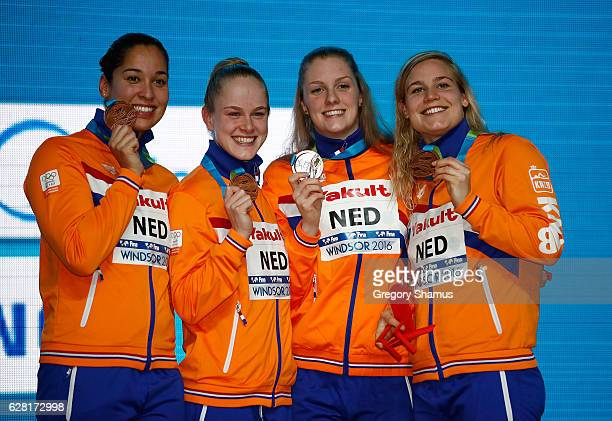 Team Netherlands celebrators with their bronze medals after the woman 4x100 Freestyle final on day one of the 13th FINA World Swimming Championships...