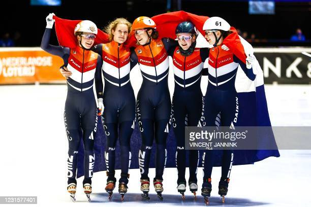 Team Netherlands celebtrates after winning the final 3000 meters relay on the final day of the ISU World Short Track Speed Skating Championships at...