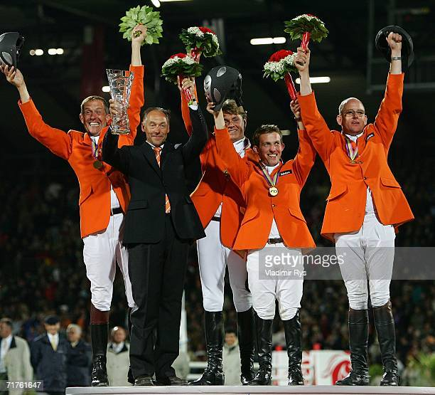 Team Netherlands Plet Raymakers team principal Rob Ehrens Jeroen Dubbeldam Gerco Schroeder and Albert Zoer celebrate ate the medal ceremony after...