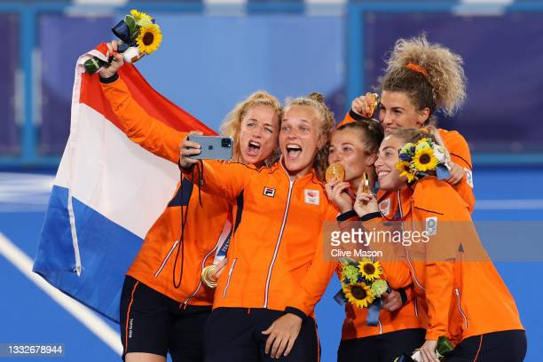 Team Netherlands pose for a selfie with their Gold Medals during the Victory Ceremony following the Women's Gold Medal match between Netherlands and...