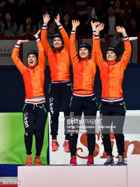 Team Netherlands react as they stand onto the podium after finishing second in the women's 3000 meter relay Final during the World Short Track Speed...