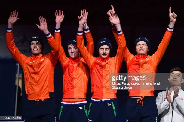 Team Netherlands react as they step onto the podium to receive their silver medals after finishing second in the men's 3000m relay final during the...