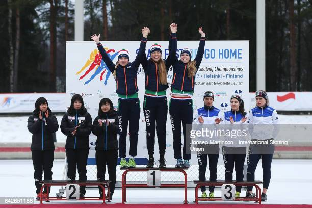 Team Netherlands team Japan and team Italy pose in the ladies team pursuit medal ceremony during day three of the World Junior Speed Skating...