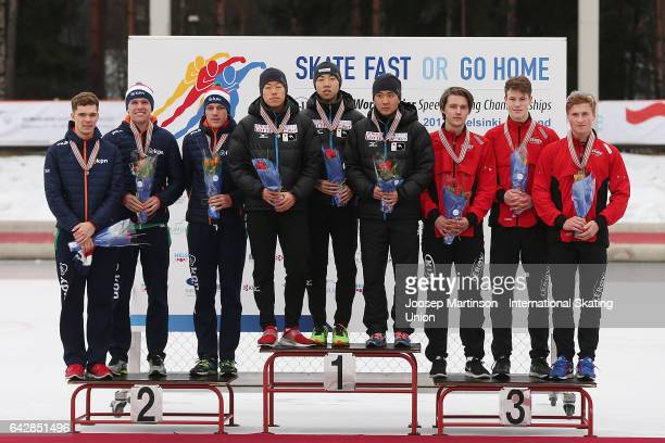 Team Netherlands team Japan and team Norway pose in the men's team pursuit medal ceremony during day three of the World Junior Speed Skating...