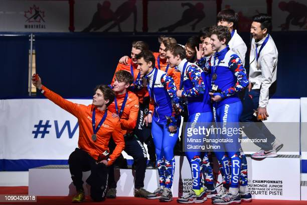Team Netherlands Team Russia and team China take a selfie picture on the podium after completing the men's 3000m relay final during the ISU World...
