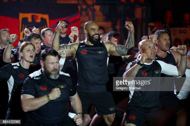 Team New Zealand celebrate with a traditional ancestral war cry called the Haka after Craig Wilson of New Zealand won the gold medal at the medal...