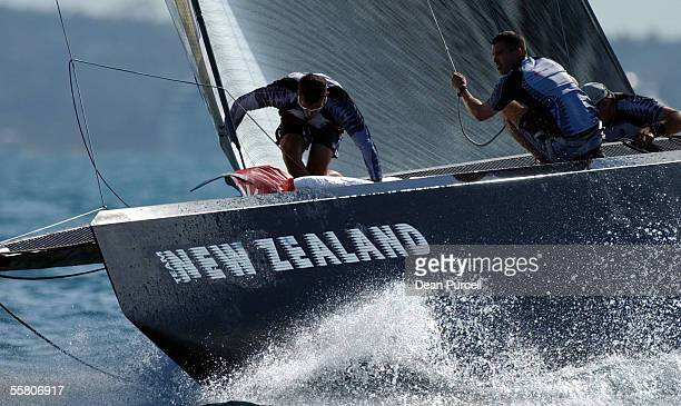 Team New Zealand crew members at work during race two of the America's Cup Alinghi came from behind on the last leg to beat Team New Zealand by seven...